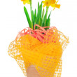 Stock Photo: Easter decorated garden flower pot with spring yellow narcissus