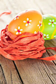Easter painted eggs and ribbon decor — Stock Photo