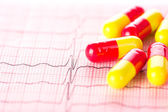 Cardiology. Macro of ECG graph and cardio pills. Shallow depth o — Stock Photo