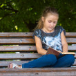 Reading at the park — Stock Photo