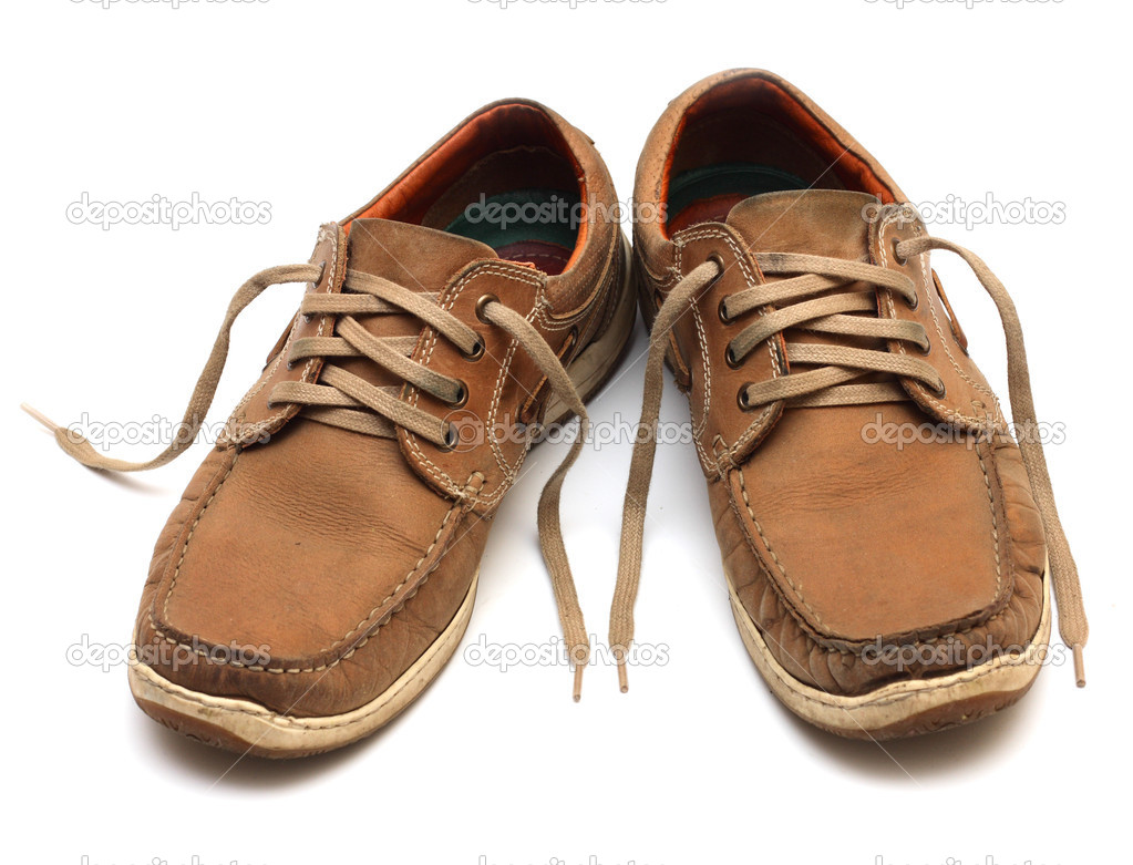 Brown man shoes isolated on a white background Photo by azgek1978