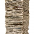 Stock Photo: Towering stack of newspapers for recycling