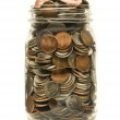 Glass jar overflowing with American coins — Stock Photo