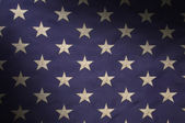 Stars in a field of blue on an American flag lit diagonally — Stock Photo