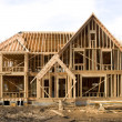 McMansion type house under construction in framing phase — Stock Photo #9633319