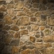 Stock Photo: Masonry rock wall lit diagonally
