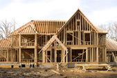 McMansion type house under construction in framing phase — Stock Photo