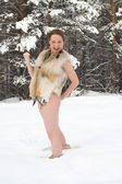 Sexy girl in fox vest on the background of the winter forest — Stock Photo