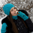 Girl with ice cream on a background of snow-covered park — Stock Photo