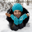 Girl with ice cream on a background of snow-covered park - Stock Photo