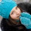 Young girl warms frozen hands your breath - Stock Photo