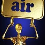 Golden skeleton holding the sign — Stock Photo #10358420