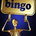 Golden skeleton holding the sign — Stock Photo #10363115