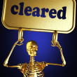 Golden skeleton holding the sign — Stockfoto