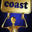 Royalty-Free Stock Photo: Golden skeleton holding the sign