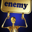 Golden skeleton holding the sign — Stock Photo #10369174