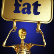 Golden skeleton holding sign — Stock Photo #10371905