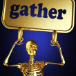 Golden skeleton holding the sign - Photo