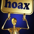 Golden skeleton holding sign — Stock Photo #10374831