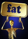 Golden skeleton holding the sign — Photo