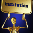 Golden skeleton holding the sign - Stockfoto