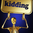 Golden skeleton holding the sign — ストック写真