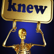 Golden skeleton holding the sign — Stock Photo #10380652