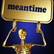Golden skeleton holding the sign — Stock Photo