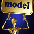 图库照片: Golden skeleton holding the sign