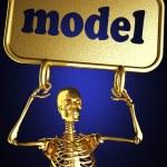 Золотой скелетон, держа знак — Стоковое фото