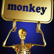 Golden skeleton holding sign — Stock Photo #10382960