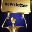 Stock Photo: Golden skeleton holding the sign