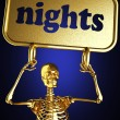 Golden skeleton holding the sign — Stock Photo #10384809
