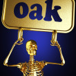 Golden skeleton holding the sign — Stock Photo #10384900