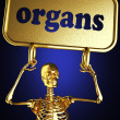 Golden skeleton holding the sign — Stock Photo #10385060