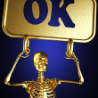 Golden skeleton holding the sign — Stock Photo #10385061