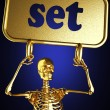 Golden skeleton holding the sign — Stock Photo #10397645