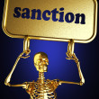 Golden skeleton holding sign — Stock Photo #10397850