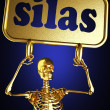 Golden skeleton holding the sign — Stock Photo #10402609