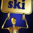 Golden skeleton holding sign — Stock Photo #10402644