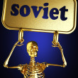 Golden skeleton holding the sign — Stock Photo #10402871