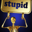 Golden skeleton holding the sign — Stock Photo #10405629