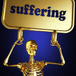 Golden skeleton holding sign — Stock Photo #10405685