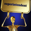 Golden skeleton holding the sign - Foto Stock