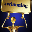 Golden skeleton holding the sign — Stock Photo #10406390