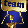 Golden skeleton holding sign — Stock Photo #10408814