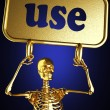 Golden skeleton holding the sign — Foto Stock
