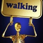 Golden skeleton holding the sign — Stock Photo #10414362