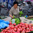 Chinese street seller - Stock Photo