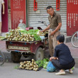 Stock Photo: Chinese street seller